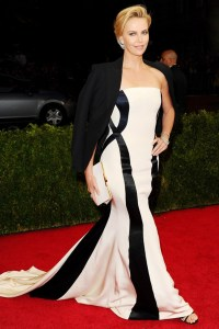 Dior Couture gown with a tuxedo jacket, Jimmy Choo sandals and Fred Leighton jewellery.